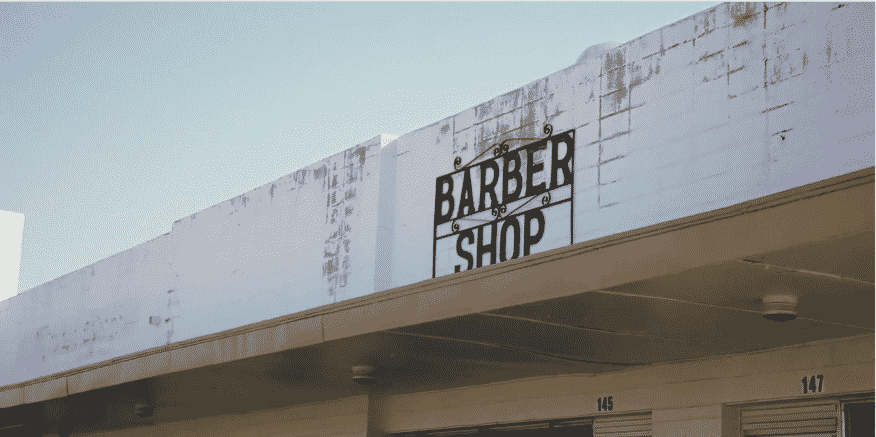 Top of building with the title Barber Shop