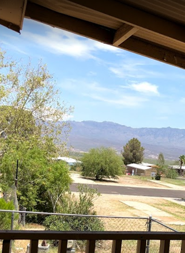 Trailer home view from the porch staring straight right into the blue mountains of Arizona.