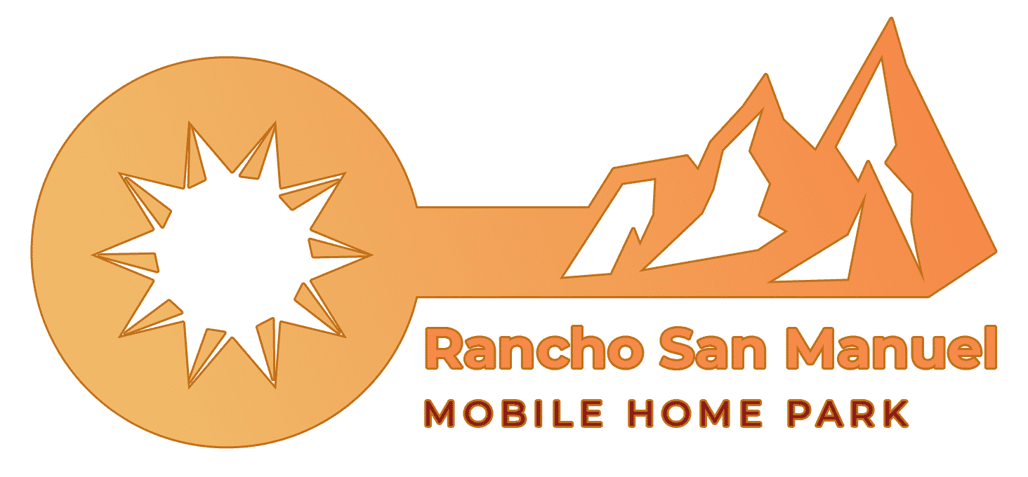 Rancho San Manuel Mobile Home Park logo shaped like a key with a sun in the keyhole and mountains as the key bumps.